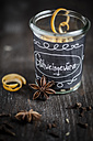 Preserving jar with spices for mulled wine on wooden table - SBDF000384