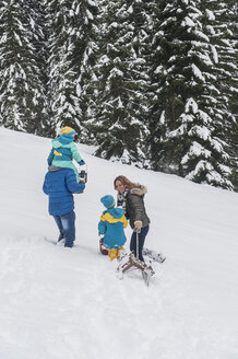 Austria, Salzburg Country, Altenmarkt-Zauchensee, Family walking in snow, pulling sledge - HHF004663