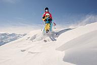 Austria, Salzburg Country, Altenmarkt-Zauchensee, Family skiing in mountains - HHF004646