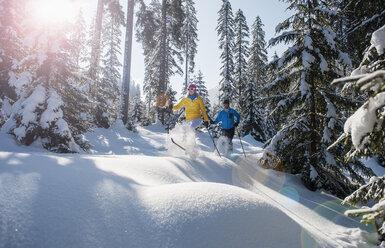 Austria, Salzburg Country, Altenmarkt-Zauchensee, Young couple cross-country skiing - HHF004661