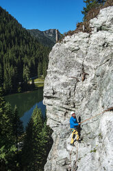 Austria, Salzburg State, Altenmarkt-Zauchensee, man at via ferrata - HHF004705
