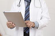 Germany, Doctor using digital tablet - DR000341