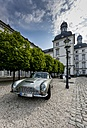 Germany, North Rhine-Westphalia, Bergisch Gladbach, Aston Martin DB6 in front of the Grandhotel Schloss Bensberg - AM001528