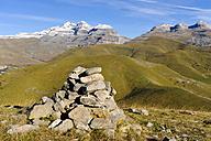 Spain, Aragon, Central Pyrenees, Canon de Anisclo, Ordesa y Monte Perdida National Park, cairn and Las Tres Marias in the background - LAF000372