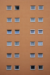 Orange house facade with squared windows - AXF000608