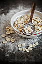 Orecchiette in a bowl and on wooden spoon, on wooden table with flour - SBDF000394