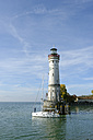 Germany, Bavaria, Swabia, Lake Constance, harbor with lighthouse and boat - LB000454