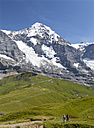 Switzerland, Bernese Oberland, Grindelwald, Hiker looking at mountain view - WW002927