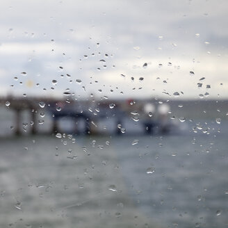 Germany,  Schleswig-Holstein, Heiligenhafen, raindrops on window. pier - WIF000246