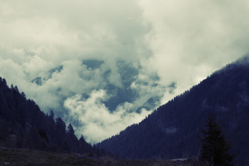 Austria, Tyrol, Assling, Angry clouds in the mountains - KAF000085