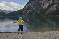 Italy, Trentino-Alto Adige, Alto Adige, Puster Valley, little boy standing at lakeshore of Lake Prags - MJF000456