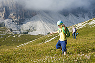 Italy, Province of Belluno, Veneto, Auronzo di Cadore, father and son hiking near Tre Cime di Lavaredo - MJF000485