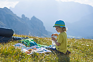 Italy, Province of Belluno, Veneto, Auronzo di Cadore, little boy and his father having a break near Tre Cime di Lavaredo - MJF000487