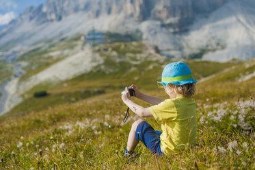 Italy, Province of Belluno, Veneto, Auronzo di Cadore, little boy photographing view near Tre Cime di Lavaredo - MJF000488