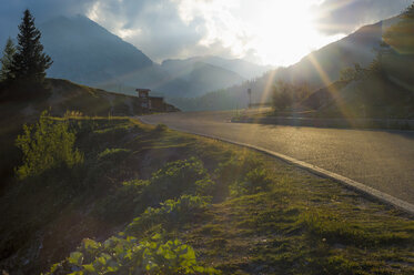 Italy, Dolomite Alps, road at evening twilight - MJF000495