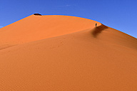 Algeria, Sahara, Tassili N'Ajjer National Park, Tadrart, woman hiking on the sand dunes of Tin Merzouga - ESF000867