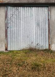 Italy, South Tyrol, Vinschgau, garage door at Stelvio Pass - WWF003023