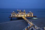 Germany, Mecklenburg-Western Pomerania, Rugia, view to lightened sea bridge at Baltic seaside resort Sellin at blue hour - WI000280