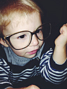 Young boy wearing mother's glasses, Bonn, NRW, Germany - MFF000708