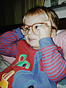 Young boy wearing pajamas and mother's glasses, Bonn, NRW, Germany - MFF000706