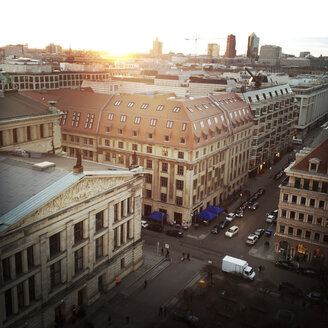 Sunset behind the skyscrapers at Potsdamer Platz with classic buildings around Gendarmenmarkt in foreground, Germany, Berlin, - ZMF000045