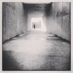 Toddler running through a square footwalk tunnel, Germany, Berlin, - ZMF000042