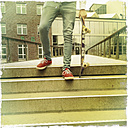 Legs of boy with a skateboard walking down the steps, croped image, Germany, Hamburg - SEF000306