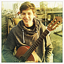 boy holding his guitar on a quai wall, Germany, Hamburg - SEF000310