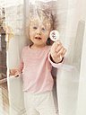 Little girl with lollipop in hand, Munich, Bavaria - GSF000596