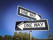 Two One Way Signs pointing in opposite directions - ABAF001155