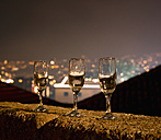 Portugal, Madeira, Funchal, Forte de Sao Tiago, three empty champagne glasses standing on balustrade at New Year's Eve - HLF000334