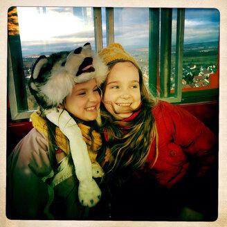 Two young girls in Freiburg im Breisgau, Baden-Wurttemberg, Germany, - DHL000252