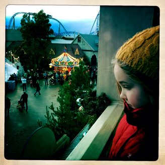 Little girl looks at the Europa Park, near city of Rust, Baden-Wuerttemberg, Germany - DHL000256