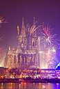 Germany, North Rhine-Westphalia, Cologne, Cologne cathedrale at New Year's Eve with fireworks - WGF000191