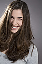 Portrait of smiling young woman, studio shot - MAEF007619