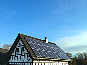 Solar roof, solar panels on the old half-timbered house, house, family house, electricity for the home, NRW, Germany - ONF000324