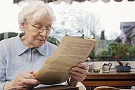 Senior women reading her old training contract - BIF000280