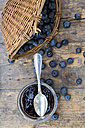 Wickerbasket with blueberries (Vaccinium myrtillus) and glass of blueberry jam on wooden table - LVF000432