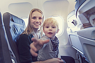 Mother with son in airplane - MF000732