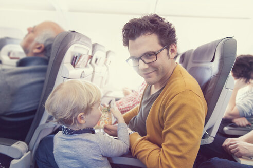 Father with son in airplane - MF000733