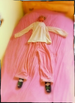 Doll in bed with kids pajamas, Germany - SRSF000446