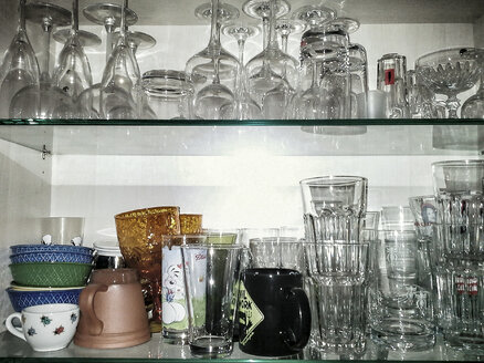 Kitchen cabinet with cups and glasses, Laupheim, Baden-Wuerttemberg, Germany, Europe - HAF000248