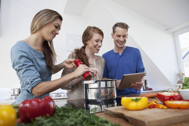 Three friends cooking together - RBF001517