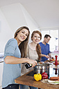 Three friends cooking together - RBF001508