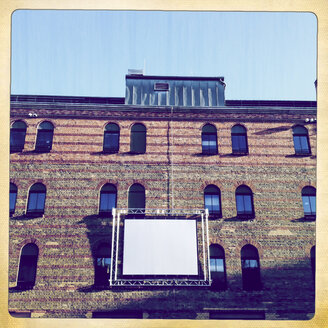 Empty screen on to industrial building facade. Culture Brewery, Berlin, Germany - ZM000079