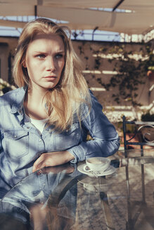 Italy, Sicily, Palermo, Blonde woman sitting in cafe - MFF000740