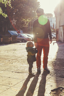 Italy, Sicily, Palermo, Father and son talking a walk - MFF000758
