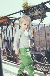 Italy, Sicily, Palermo, Blond boy on balcony - MFF000760