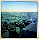 Dining table and chairs at seafront, Puntinak, Brac, Croatia - DISF000305