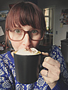 Woman with coffee cup at home, selfie, Bonn, NRW, Germany - MEAF000057